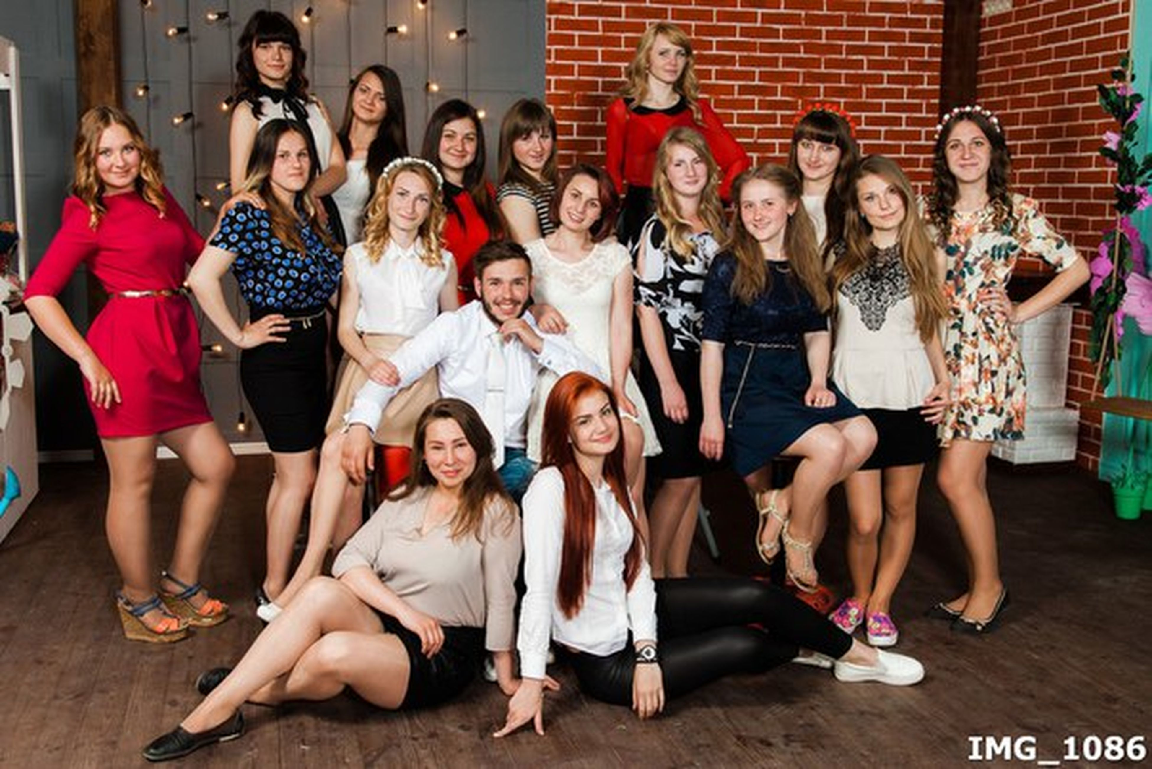 child, friendship, girls, portrait, full length, looking at camera, sitting, fun, teenager, lifestyles, people, pre-adolescent child, togetherness, large group of people, party - social event, childhood, cheerful, children only, females, smiling, student, indoors, adult