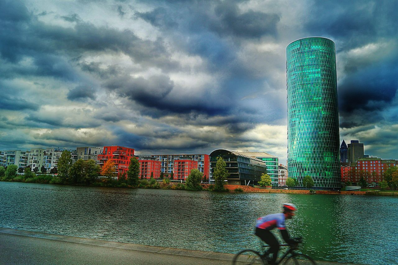S' Gerippte people gave the Skycraper the name of a typical Apple Wine -glas Riverscape Riverbanks Main River Skyline Frankfurt Dramatic Sky Cloudy Sky Architecture Building Exterior Nature CyclingUnites Movement Hdr Edit Storm Cloud City Water Day Frankfurt Am Main Germany🇩🇪 Adapted To The City