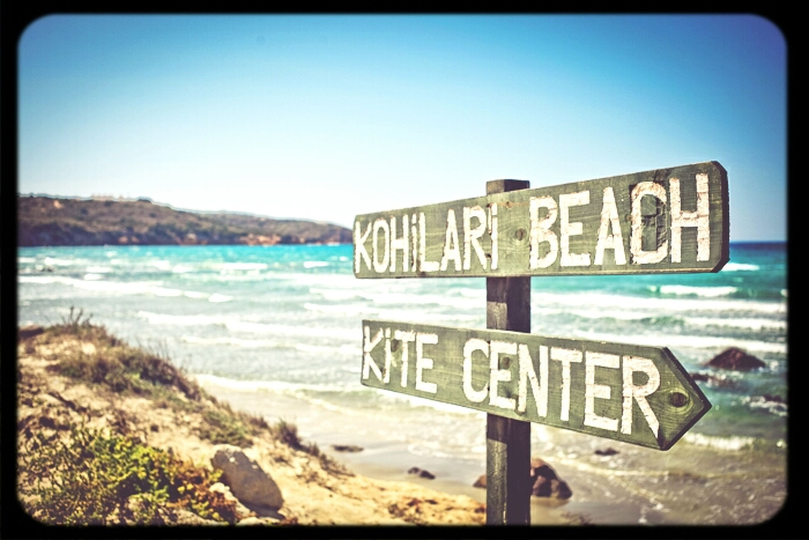 text, western script, communication, clear sky, blue, water, sea, sign, information sign, beach, capital letter, guidance, transfer print, warning sign, copy space, information, auto post production filter, shore, sand, sky