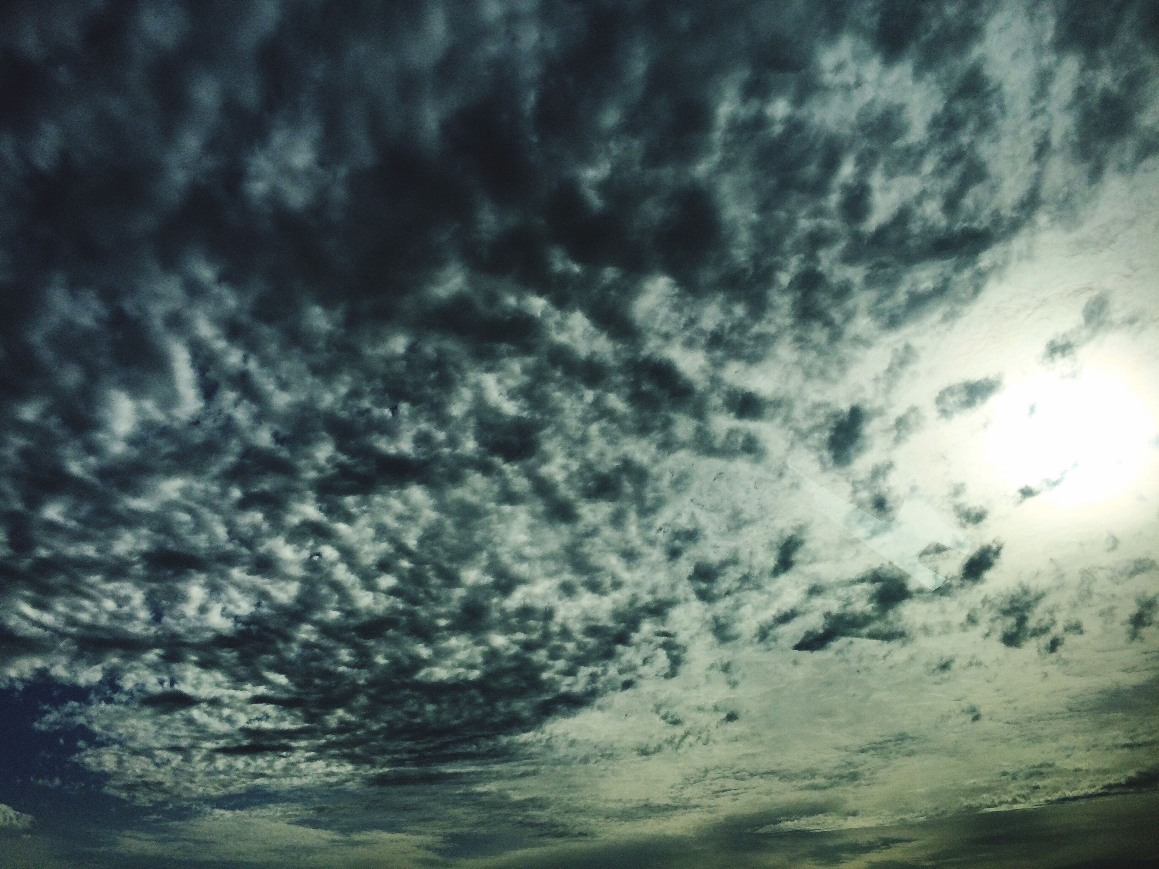 sky, cloud - sky, cloudy, beauty in nature, low angle view, tranquility, scenics, tranquil scene, nature, weather, cloudscape, cloud, overcast, idyllic, sky only, backgrounds, outdoors, storm cloud, dramatic sky, no people