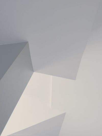 Indoors  White Color Close-up Flooring Copy Space Wall - Building Feature Modern Geometric Shape Architecture Architectural Sparse Steps Stairs Architectural Feature Full Frame No People Indoor