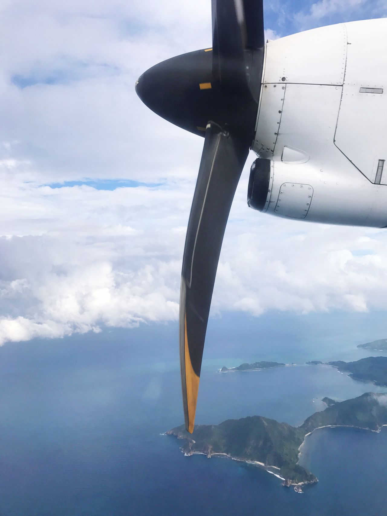 Flying in a super small plane. Airplane Flying Cloud - Sky Sky Mode Of Transport Air Vehicle Mid-air Aerial View Transportation Day Scenics Aircraft Wing Outdoors Sea Nature Airplane Wing Propeller Islands View Airplane Window Looking Down Tropical Vacation Engine