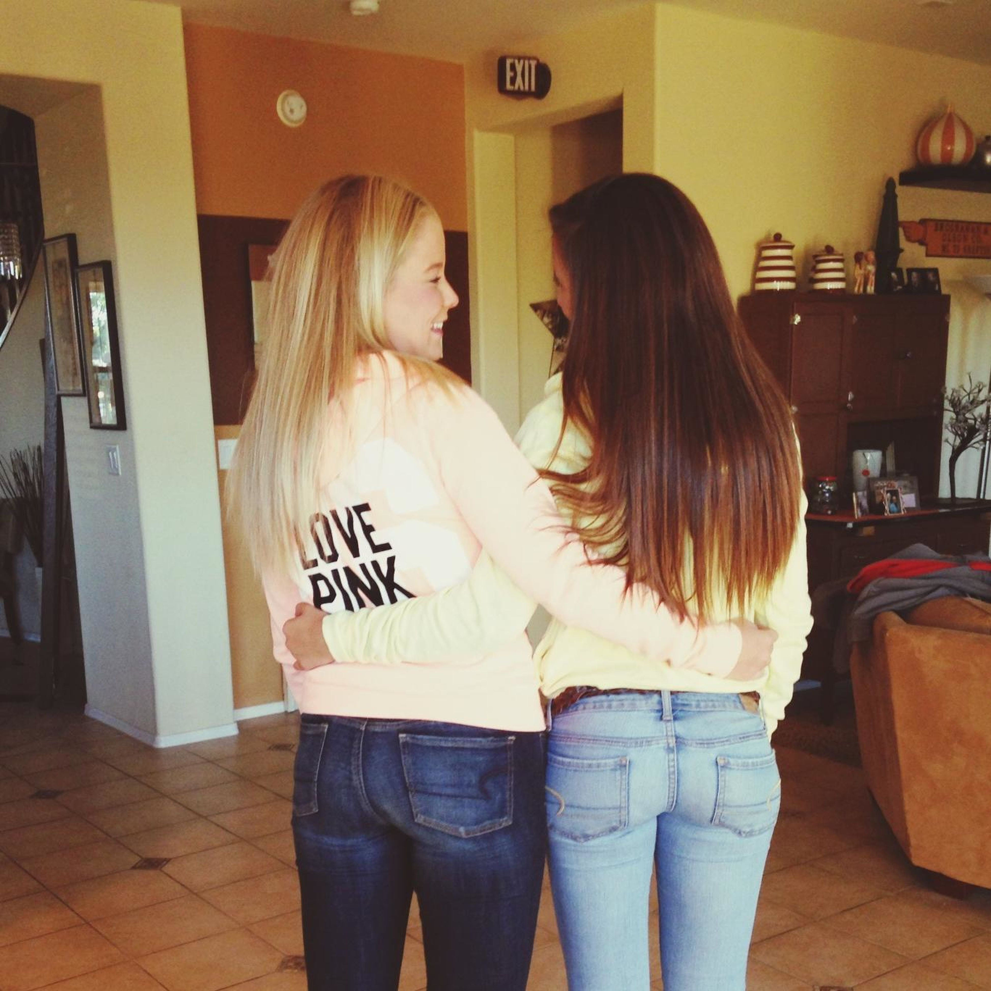 lifestyles, casual clothing, indoors, three quarter length, person, long hair, young women, leisure activity, standing, waist up, young adult, togetherness, bonding, rear view, blond hair, communication, love