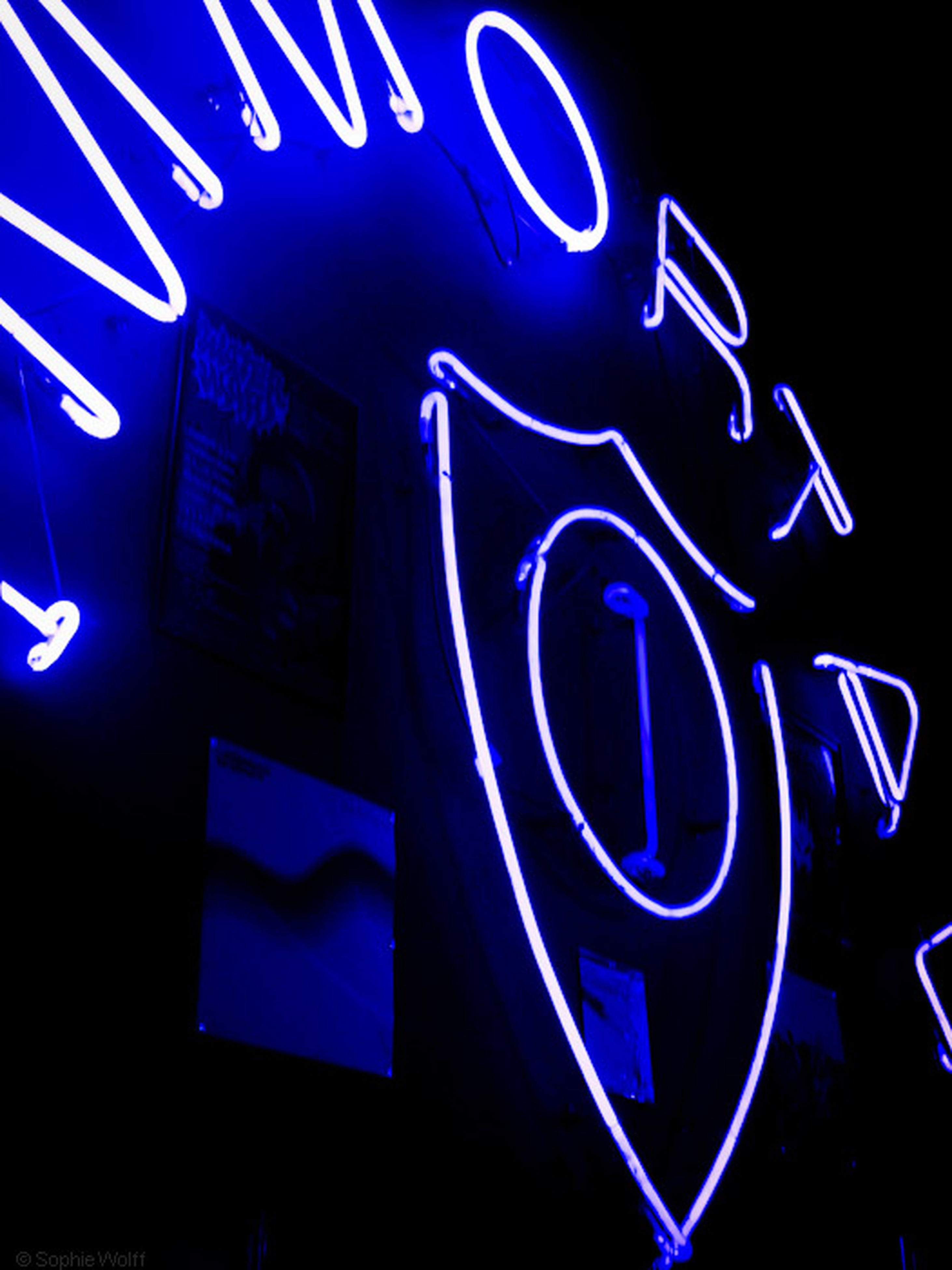 illuminated, text, communication, western script, night, indoors, blue, neon, capital letter, close-up, art, creativity, sign, art and craft, light - natural phenomenon, pattern, multi colored, guidance, no people, glowing