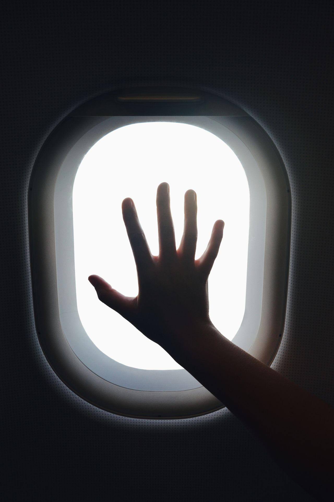 Traveling Home For The Holidays Hand Silhouette Shadow Indoors  Frosted Glass Traveling Window Airplane Flying Clouds Heading Home Africa