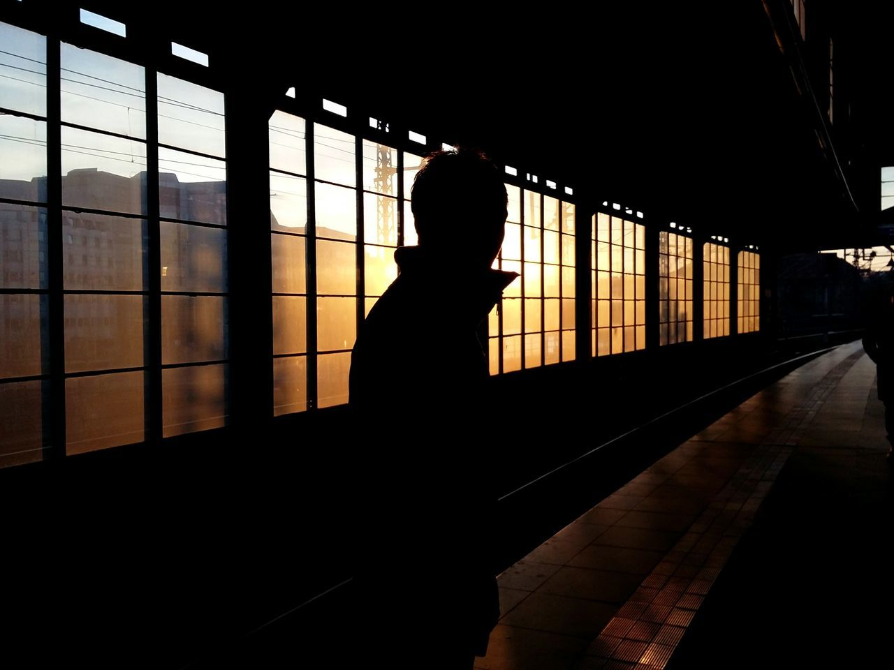 friend in the sunset. · Berlin germany 030 metro station train station Against the light light and shadow Silhouette Silhouettes darkness and light Architecture Metal beams simplicity Urban geometry