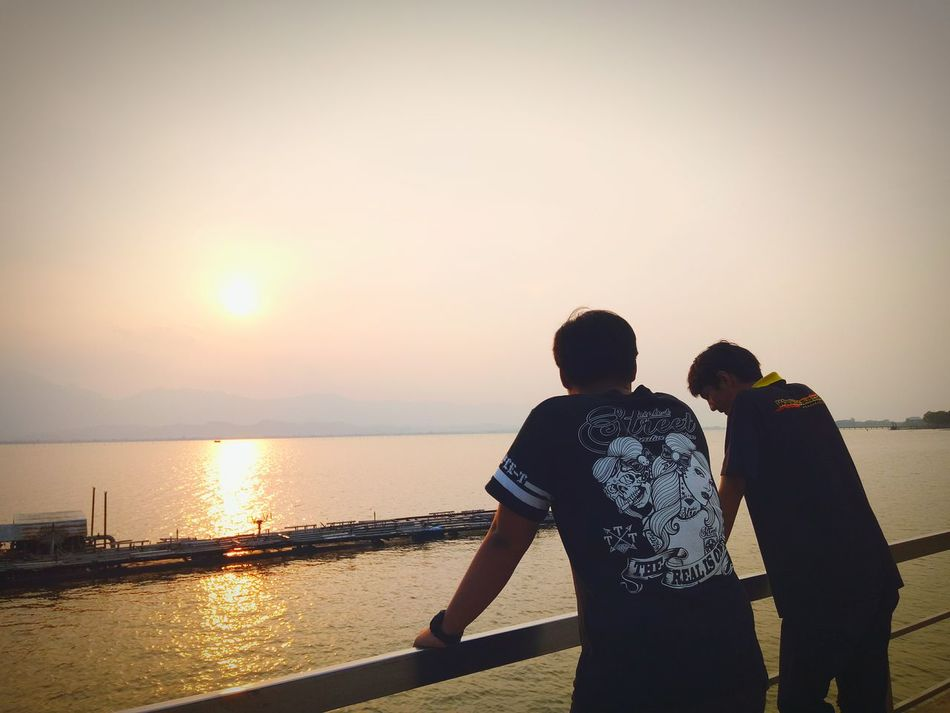 Two People Sunset Sea Men Hat Heterosexual Couple Adults Only Rear View Lifestyles Adult Women Standing Water Beach Nature Silhouette Togetherness Outdoors People Young Adult