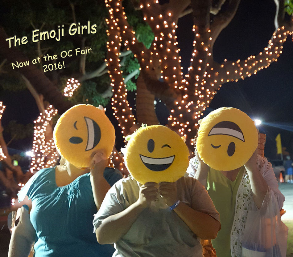 Emojis Emoji Pillows Hello World Enjoying Life That's Me Check This Out Hanging Out Orange County Fair Trees With Lights Yellow Color Night Smily Faces. My girls and I -taken from 3 separate photos and blended with a bit of photoshop magic.
