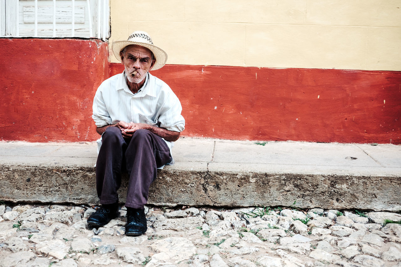 Cigar? Adult Architecture Building Exterior Built Structure Cuba Day Front View Full Length Lifestyles Looking At Camera Mature Adult Mature Men Men One Man Only One Person Only Men Outdoors People Portrait Real People Red Sitting Smiling