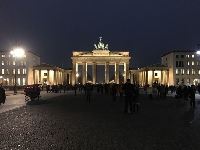 City Gate Architecture Built Structure Large Group Of People Night Illuminated Travel Destinations City Sky Light Effect Statue Sculpture Outdoors People Brandenburg Gate