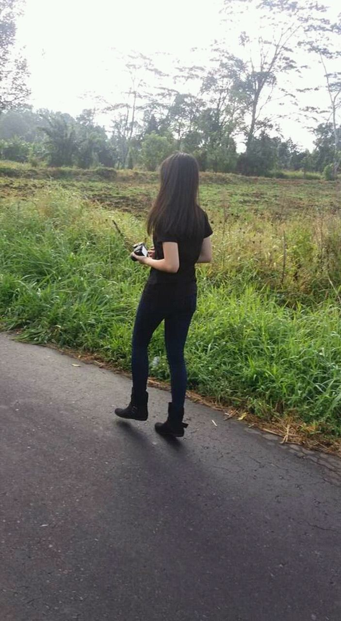 one person, full length, real people, road, casual clothing, women, grass, outdoors, nature, day, sky, adult, people