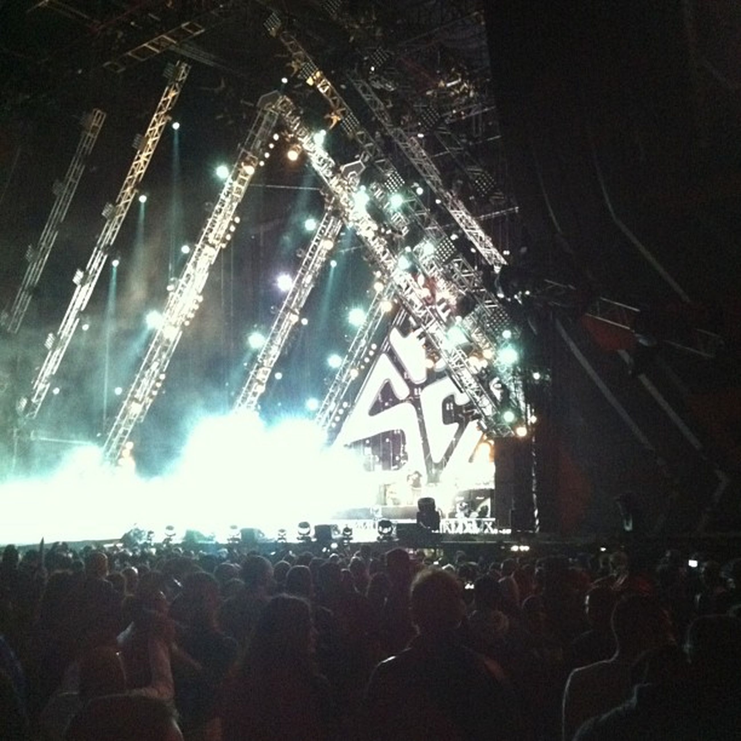 large group of people, illuminated, crowd, arts culture and entertainment, night, lifestyles, music, person, enjoyment, leisure activity, men, event, nightlife, performance, music festival, fun, stage - performance space, popular music concert