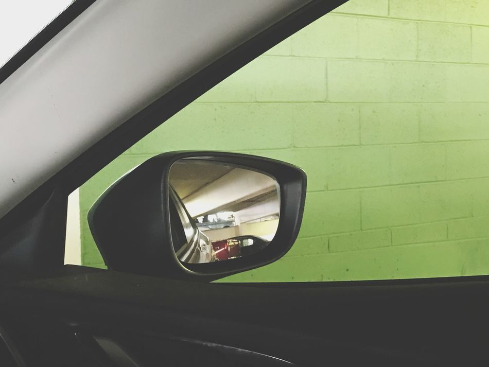 Green wall in a parking deck. Transportation Car Land Vehicle Mode Of Transport No People Day Side-view Mirror Close-up Outdoors Vehicle Mirror Parking Parking Garage