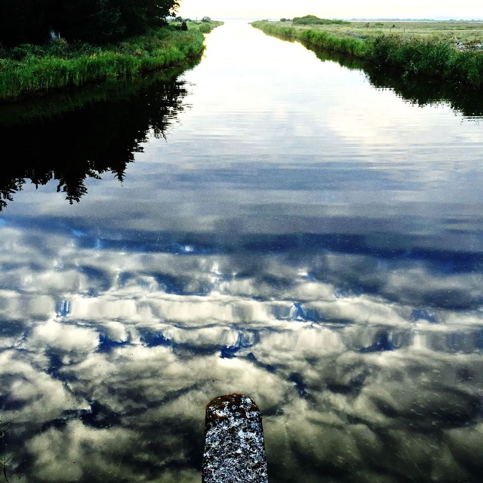 Reflection Water Scenics Tranquility Beauty In Nature Tranquil Scene Nature Day Waterfront Non-urban Scene Cloud - Sky Outdoors Calm Cloudscape Remote Softness Aerial View Non Urban Scene Majestic No People 1pointperspective