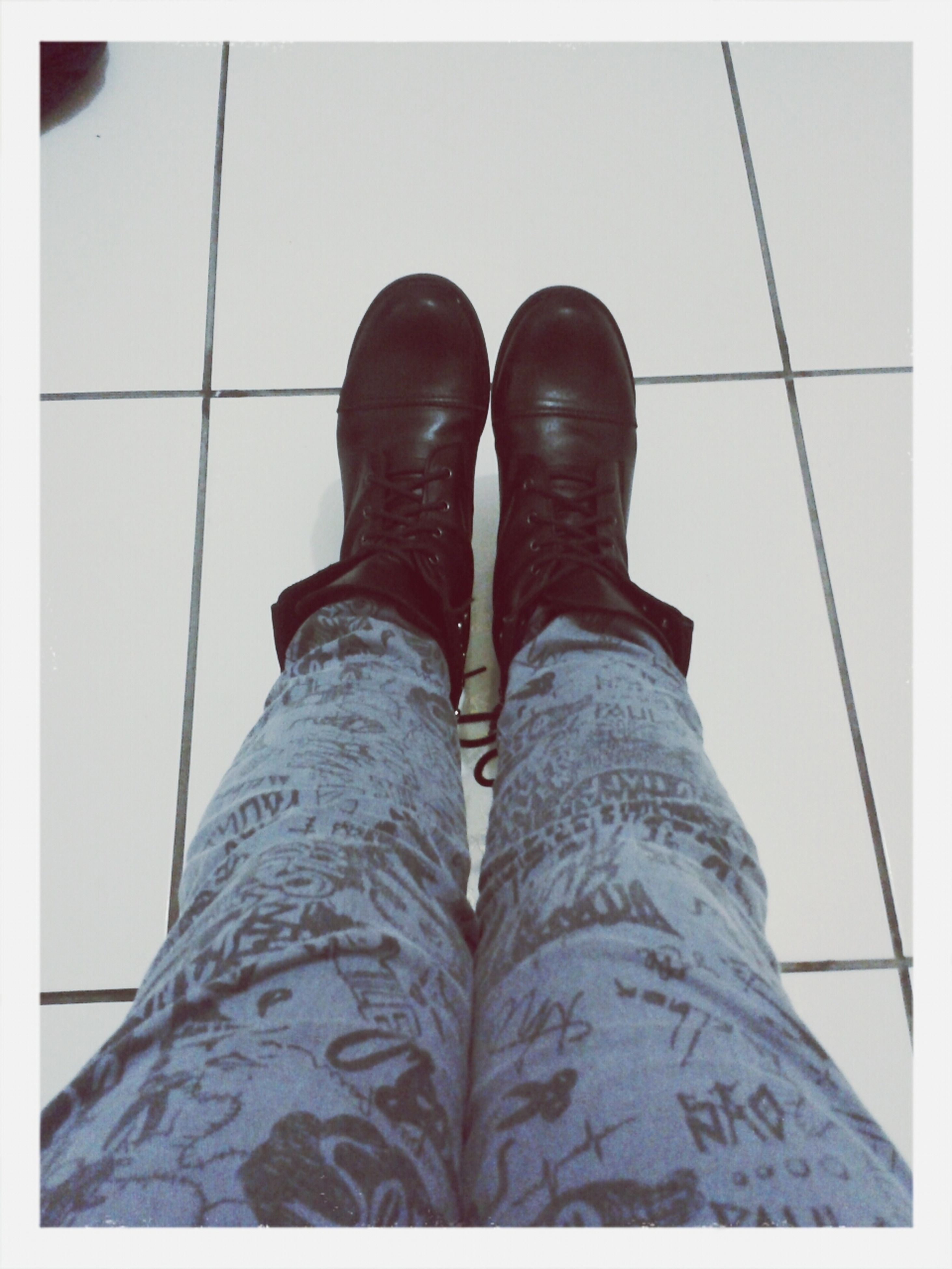 low section, person, shoe, personal perspective, indoors, human foot, jeans, footwear, tiled floor, transfer print, auto post production filter, part of, flooring, standing, close-up, high angle view, fashion