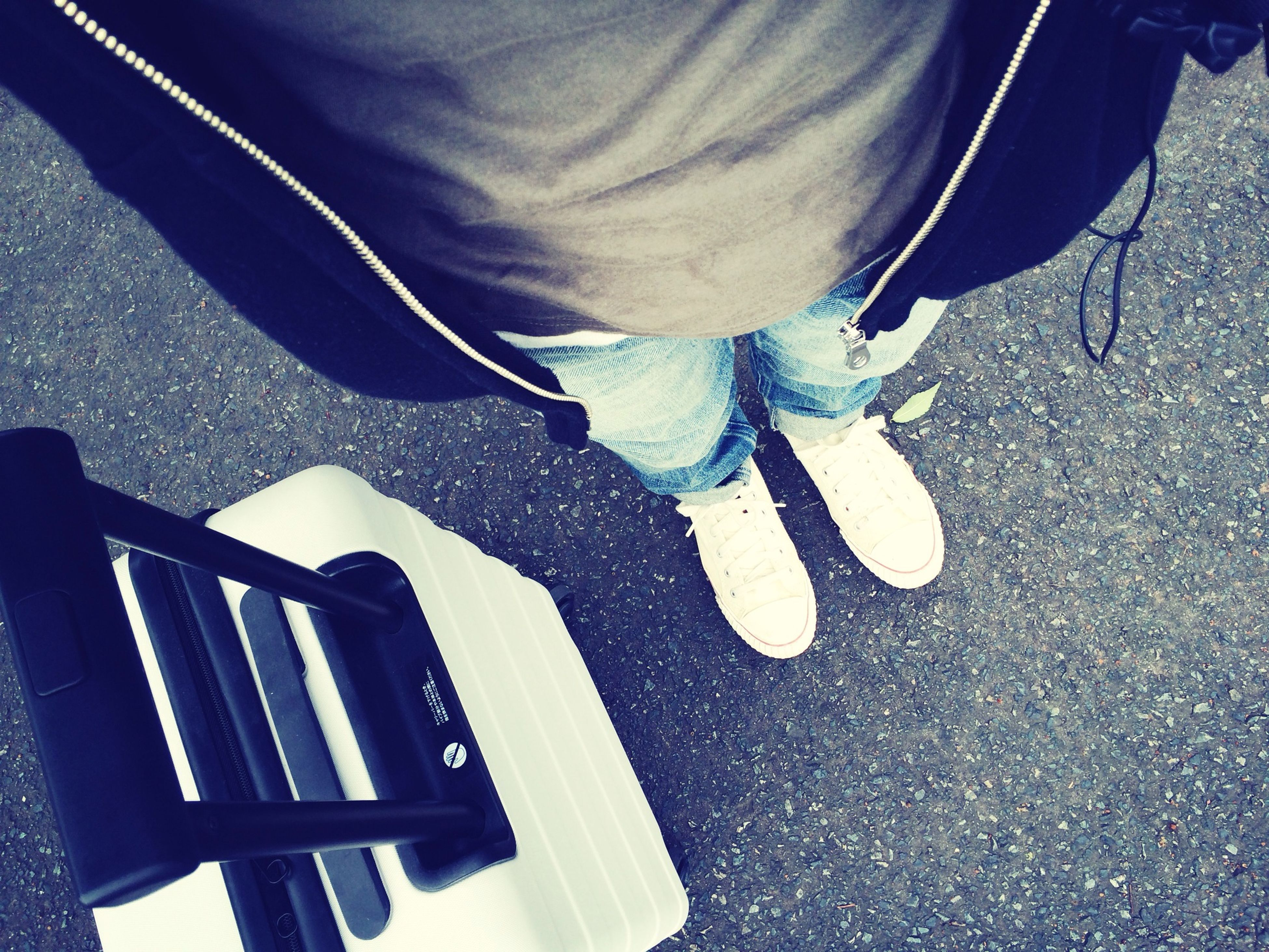 low section, person, high angle view, shoe, lifestyles, leisure activity, footwear, street, casual clothing, standing, jeans, shadow, men, human foot, road, sunlight, high heels