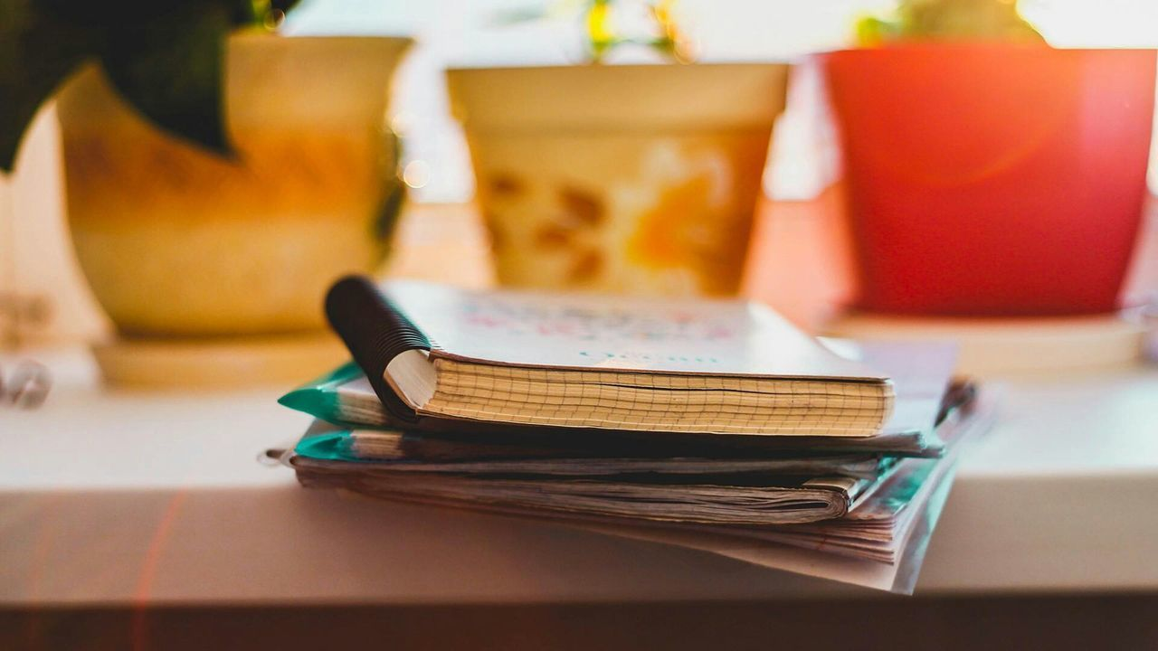 book, table, indoors, education, still life, stack, no people, desk, close-up, diary, literature, desk organizer, day