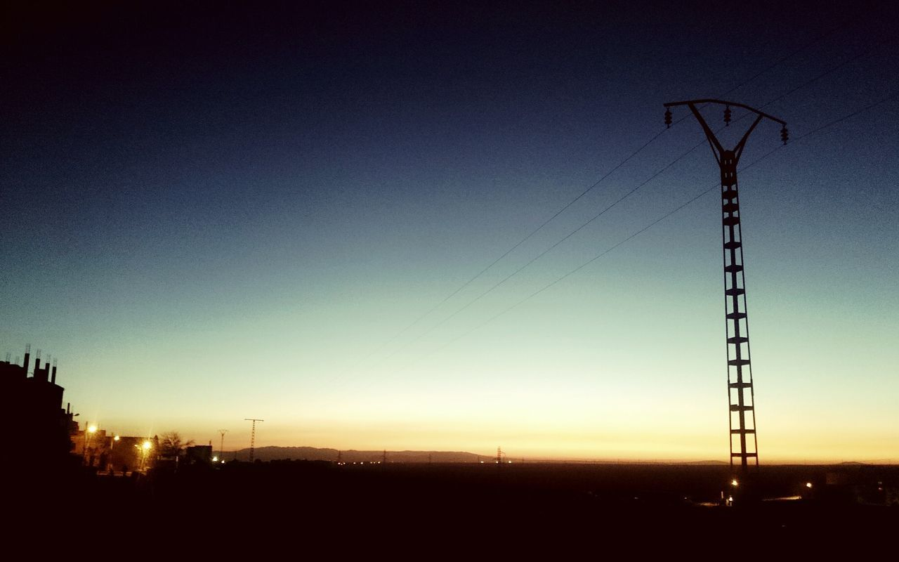sunset, no people, clear sky, connection, cable, silhouette, nature, electricity pylon, sky, blue, outdoors, electricity, low angle view, fuel and power generation, landscape, scenics, technology, beauty in nature, day