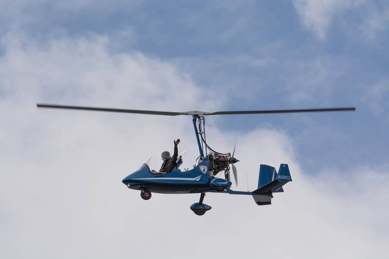 low angle view, helicopter, mode of transport, sky, day, air vehicle, transportation, outdoors, no people, flying, airplane