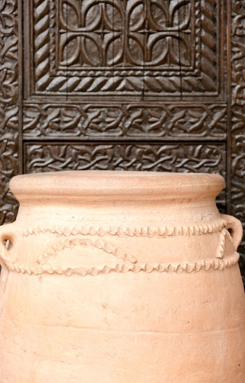 Large light brown golden color clay jar, flower pot. Focus on shape and ornaments close up shot Ancient Antique Art BIG Bowl Ceramic Clay Pot Close-up Contrast Decortive  Details Earthware Edge Empty Flowers Light Brown No People Ornaments Pattern Pot Precision Stone Tradition Vintage Vintage Style
