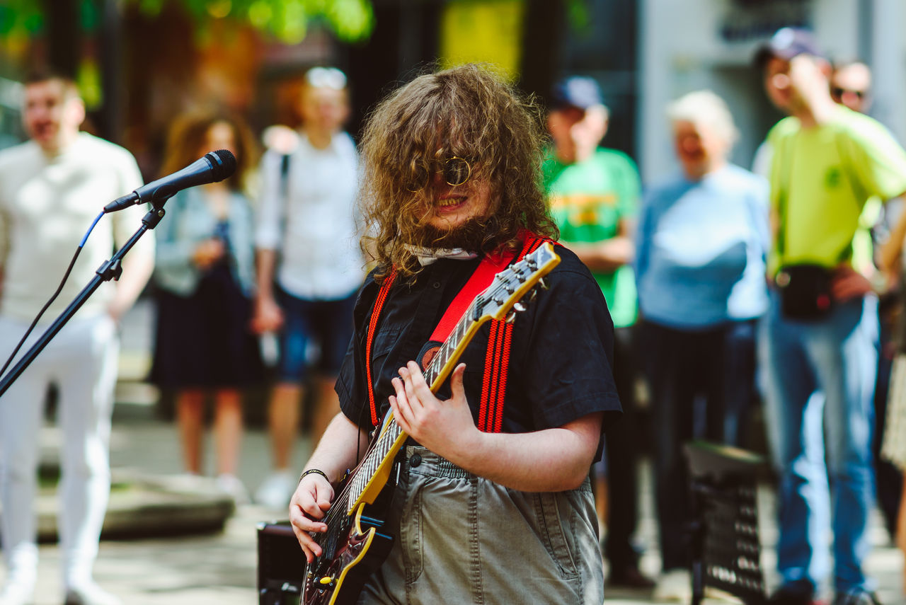 Street Music Day Arts Culture And Entertainment Day Event Focus On Foreground Incidental People Leisure Activity Lifestyles Men Music Musical Instrument Musician Occupation One Person Outdoors People Performance Portrait Real People Rear View Standing