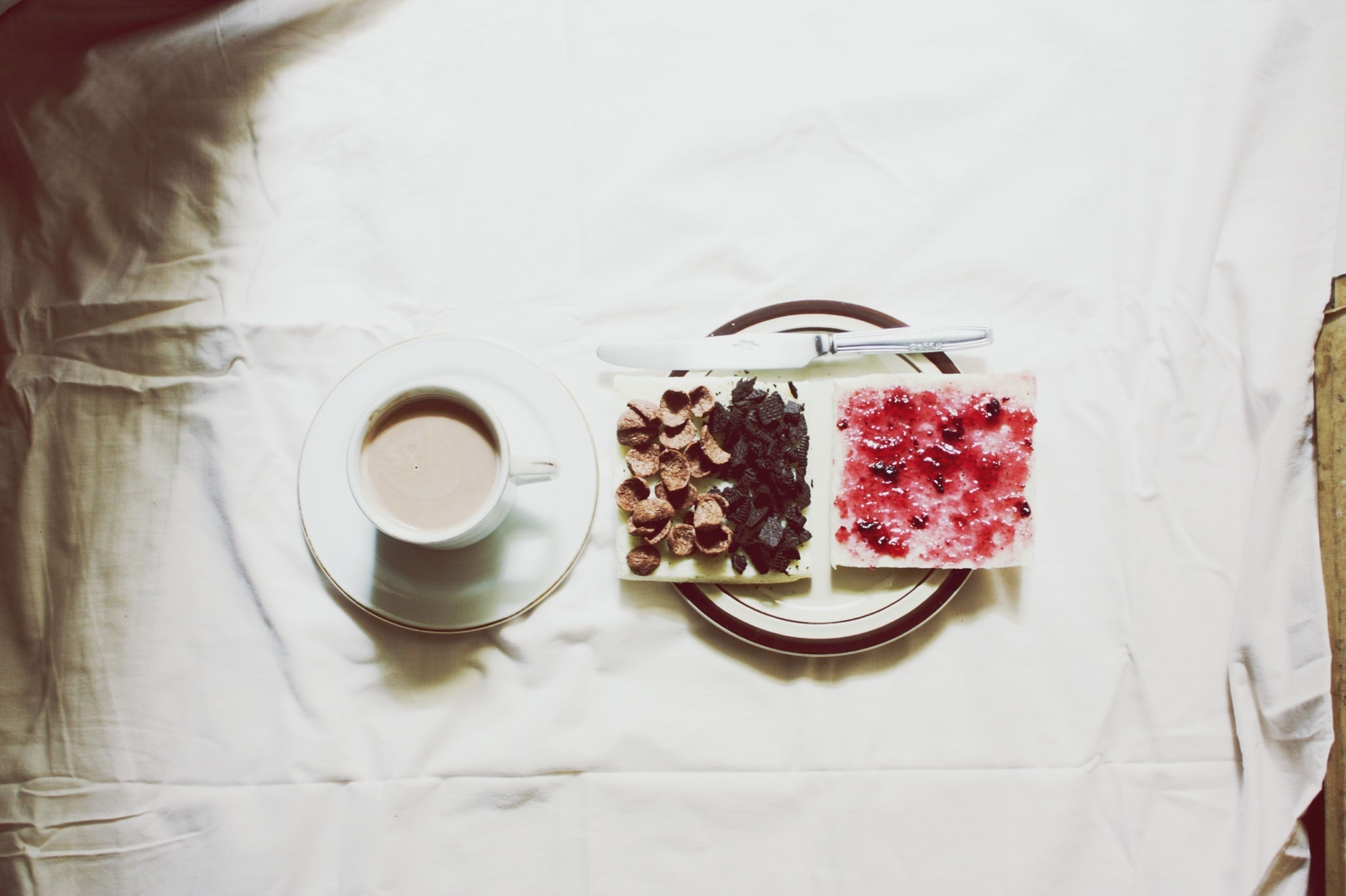 food and drink, indoors, freshness, drink, food, table, still life, refreshment, plate, coffee cup, high angle view, healthy eating, drinking glass, sweet food, ready-to-eat, coffee - drink, cup, directly above, fruit, red