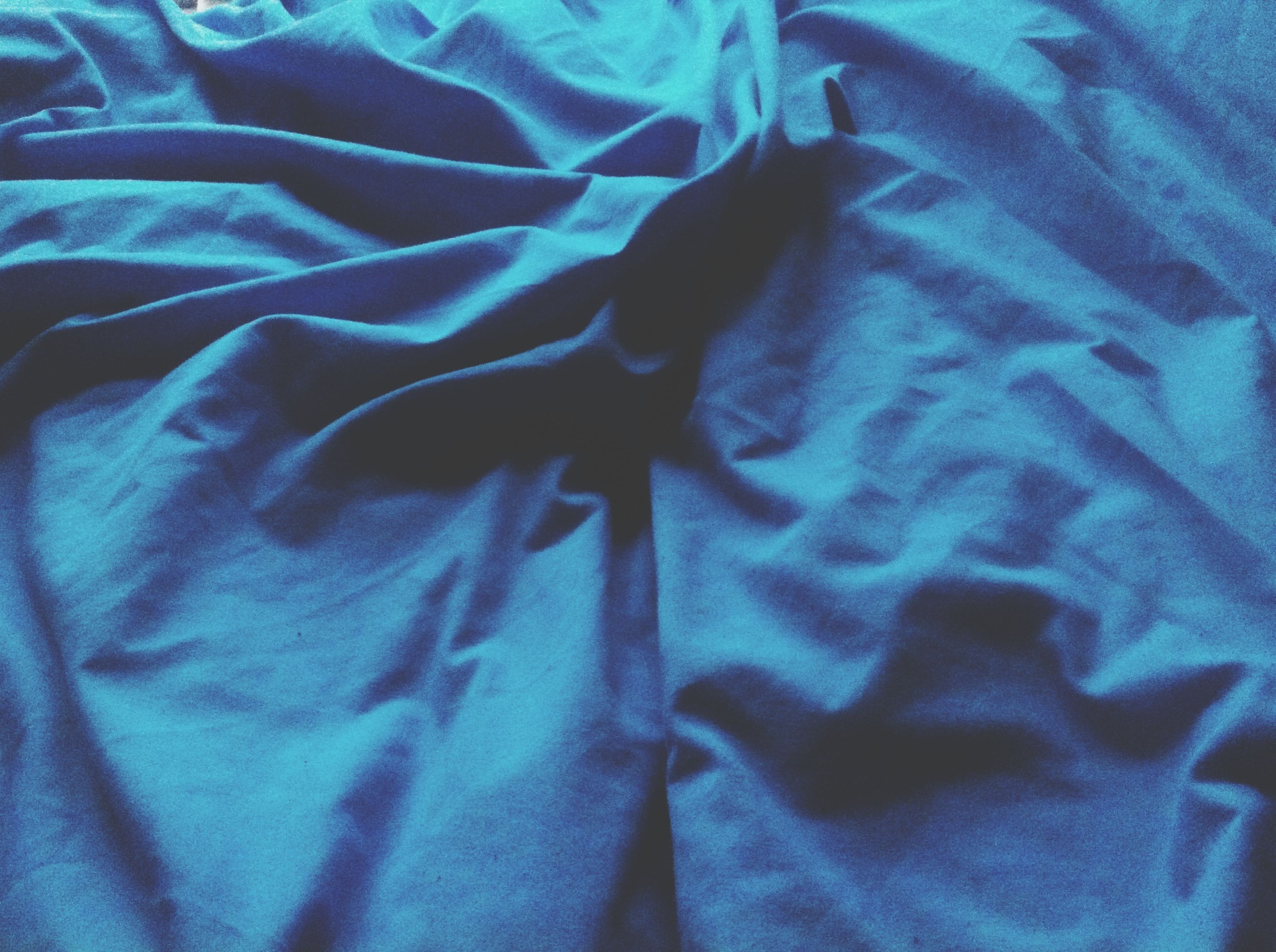 indoors, textile, fabric, blue, close-up, pattern, bed, one person, high angle view, full frame, design, backgrounds, auto post production filter, striped, clothing, textured, art, creativity, art and craft