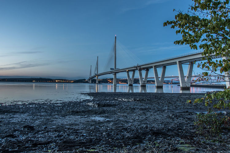Queensferry Crossing, Queensferry Queensferry  Queensferry Crossing Scotland Architecture Bridge - Man Made Structure Built Structure Connection Day Nature Newbridge Nikonphotography No People Outdoors Pauldroberts River Sky Transportation Tree Water The Week On EyeEm