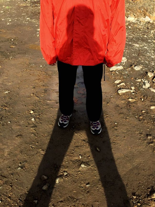 Illusion Of A Fixed Reality Low Section Outdoors Red Real People Leisure Activity Day One Person People Adult Shadows & Lights Shadowplay Rocky Landscape Red Jacket Black Trousers Sneekers Triangular Shapes