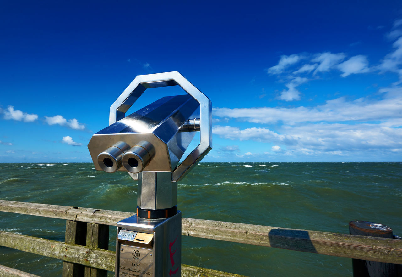 coin operated, coin-operated binoculars, binoculars, sky, sea, observation point, railing, telescope, hand-held telescope, water, blue, scenics, tranquility, horizon over water, tranquil scene, cloud - sky, nature, day, no people, beauty in nature, outdoors, close-up