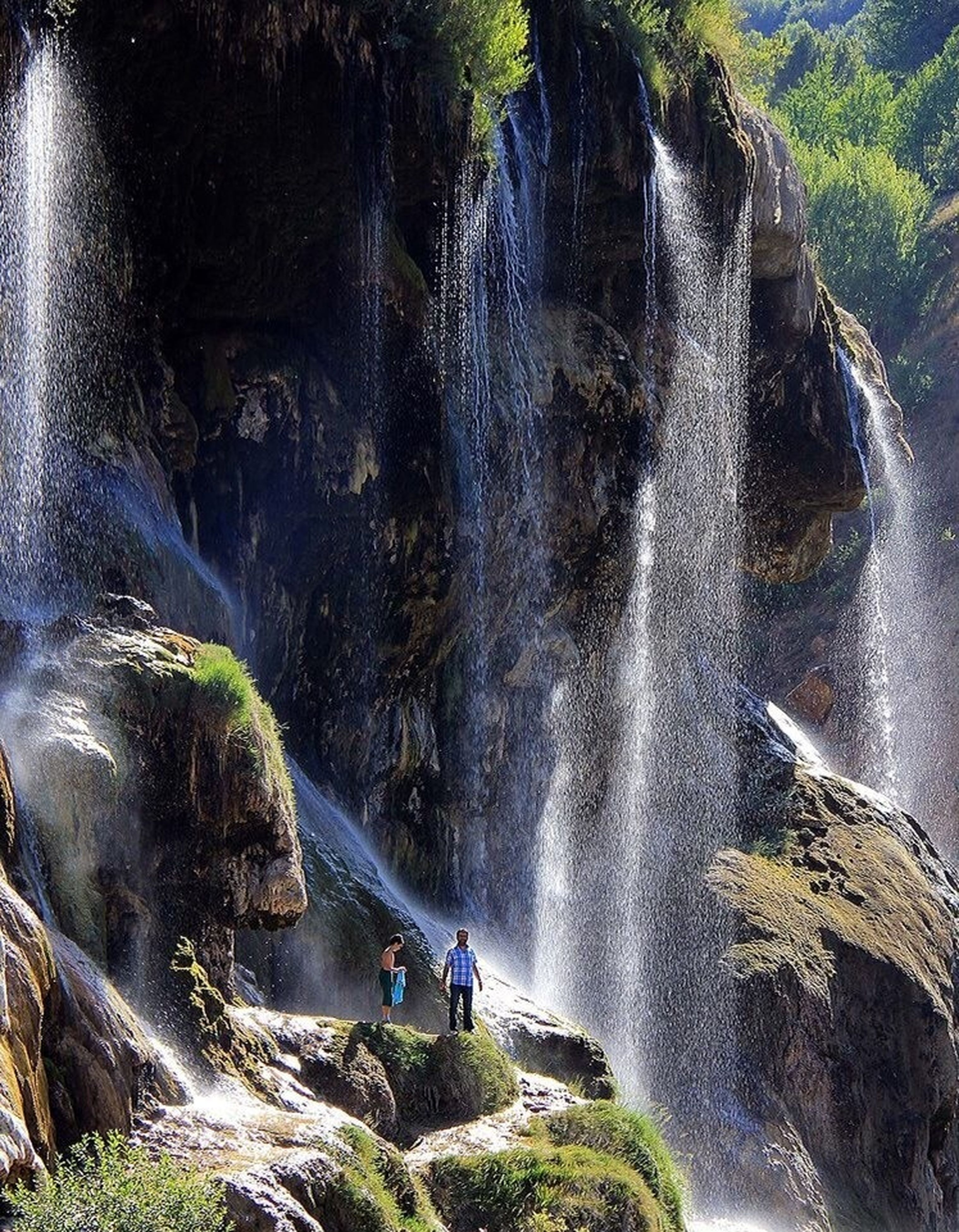 water, motion, waterfall, flowing water, flowing, beauty in nature, rock - object, river, long exposure, nature, scenics, tree, surf, splashing, travel, rock formation, transportation, high angle view, blurred motion, tourism