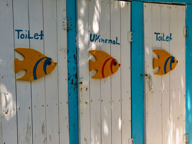 Blue Close-up Closed Day Doors Fish Carving Information Information Sign Multi Colored No People Outdoor Toilet Outdoors Sky Toilet Urinal Yellow