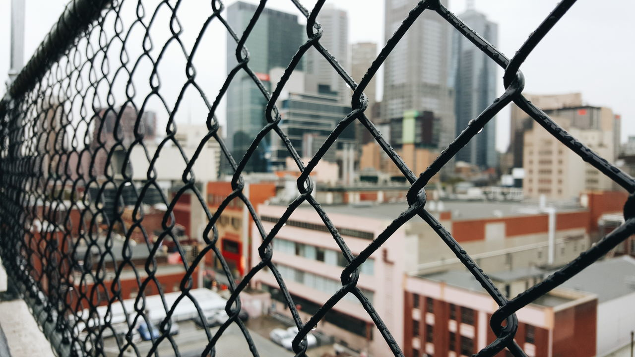 Buildings Seen From Chainlink Fence