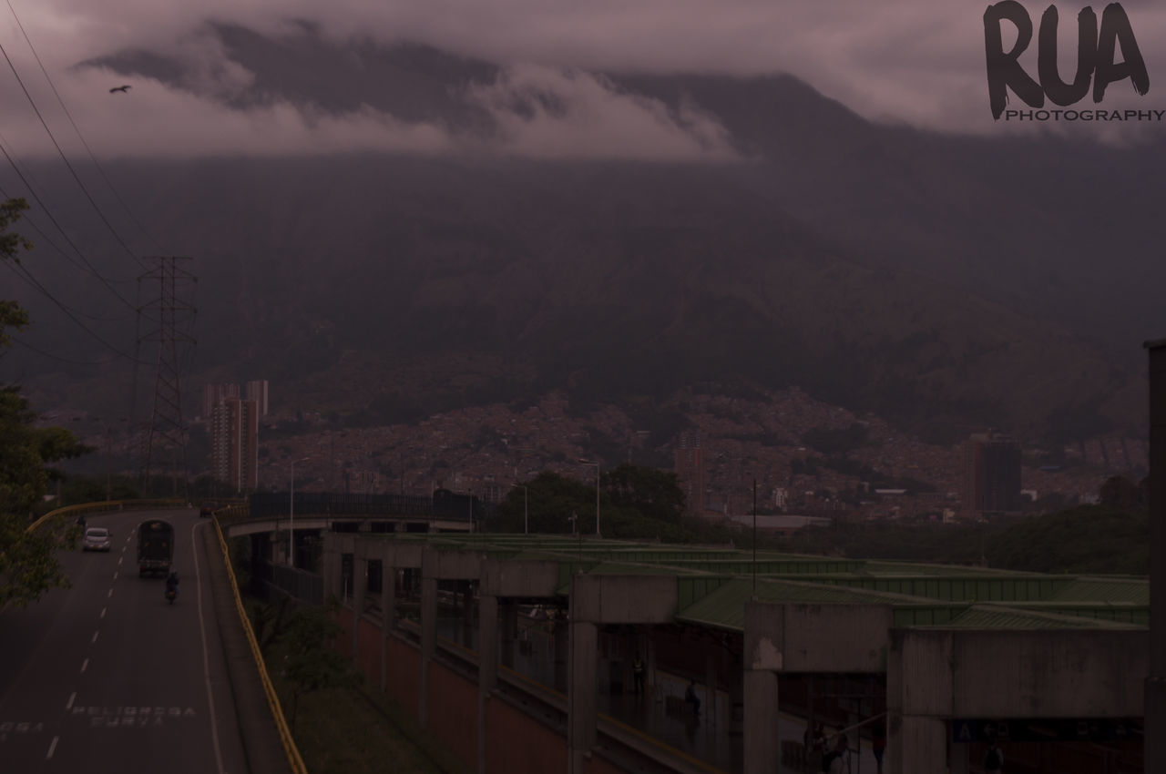 transportation, mountain, road, sky, mode of transport, car, no people, outdoors, nature, architecture, city, day