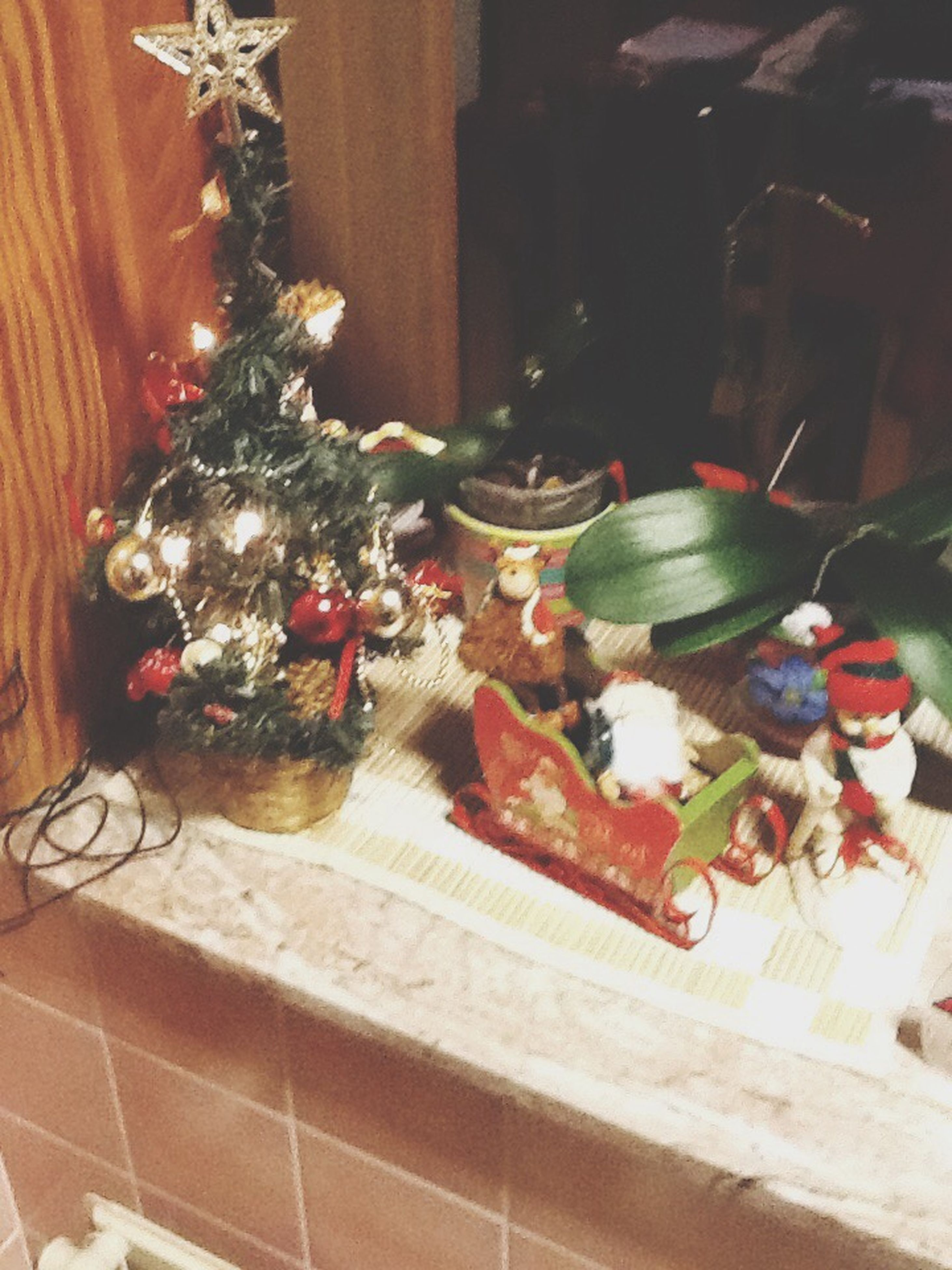 indoors, table, decoration, home interior, celebration, christmas, still life, christmas decoration, tradition, decor, christmas tree, variation, no people, food, food and drink, multi colored, cultures, hanging, animal representation, art and craft
