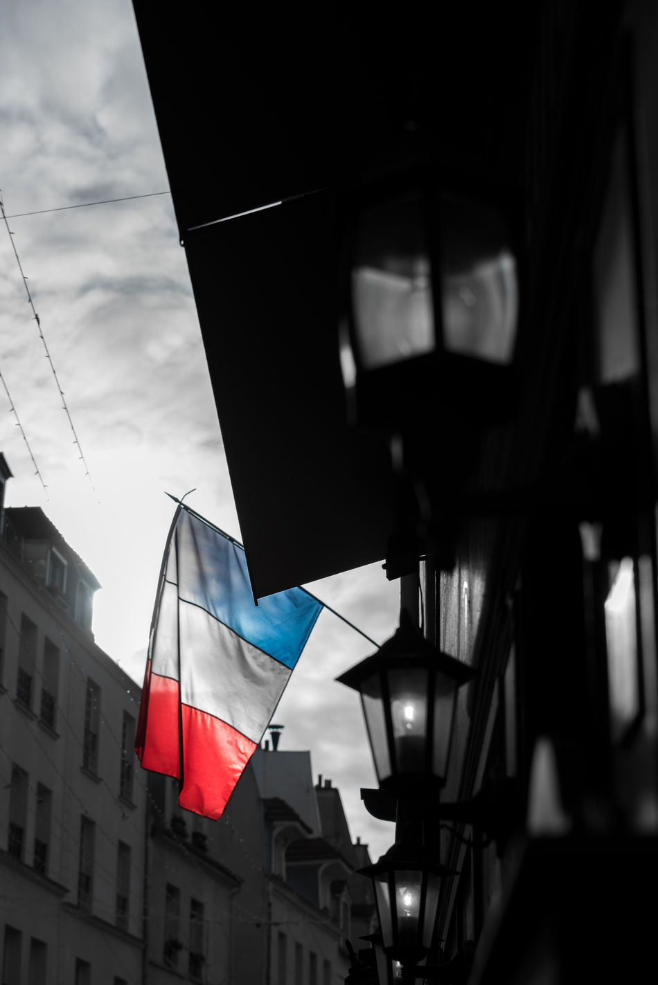 Architecture Building Exterior Built Structure Cloud - Sky Day Flag French Flag Low Angle View No People Outdoors Paris Patriotism Sky