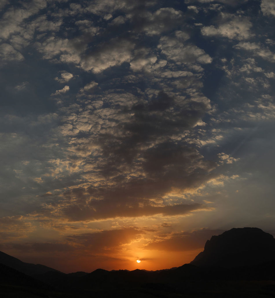 Gloomy sunset Beauty In Nature Cloud Cloud - Sky Cloudy Dramatic Sky Idyllic Landscape Majestic Mountain Mountain Range Nature No People Non Urban Scene Orange Color Outdoors Panaroma Physical Geography Scenics Sky Sun Sunbeam Sunset Sunset_collection Tranquil Scene Tranquility