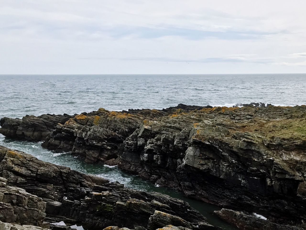 sea, horizon over water, sky, nature, beauty in nature, rock - object, scenics, rock formation, water, tranquility, no people, tranquil scene, cloud - sky, outdoors, day