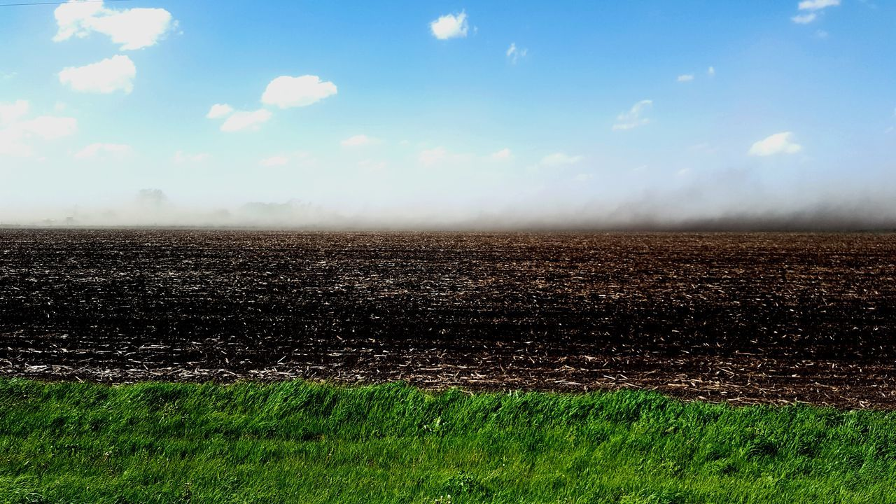 Dust storm sweeping Eastern Michigan. Sky Day Cloud - Sky Outdoors Field Agriculture Grass Rural Scenes Green Grass Blue Sky Nature Landscape No People Scenics Beauty In Nature Dust Storm Dust In The Wind Plowed Field