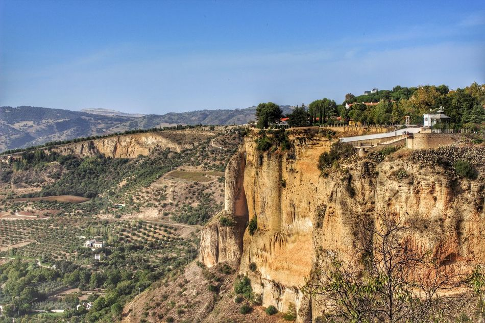 Scenics Sky Landscape Mountain Cliff Cliffs Cliffside Clifftop High Angle View Andalucian Town Ronda Andalucia Ronda, Malaga Ronda Spain Ronda Scenic Landscapes Cliff Face Cliff View Cliff Edge Distant Mountains Architecture Nature Tranquility Sunny Day Near The Edge Looking Down