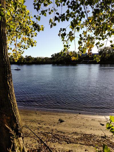 Riverside Blue Boat Sunlight Lake Reflection Tranquility Scenics Sky Day Tranquil Scene