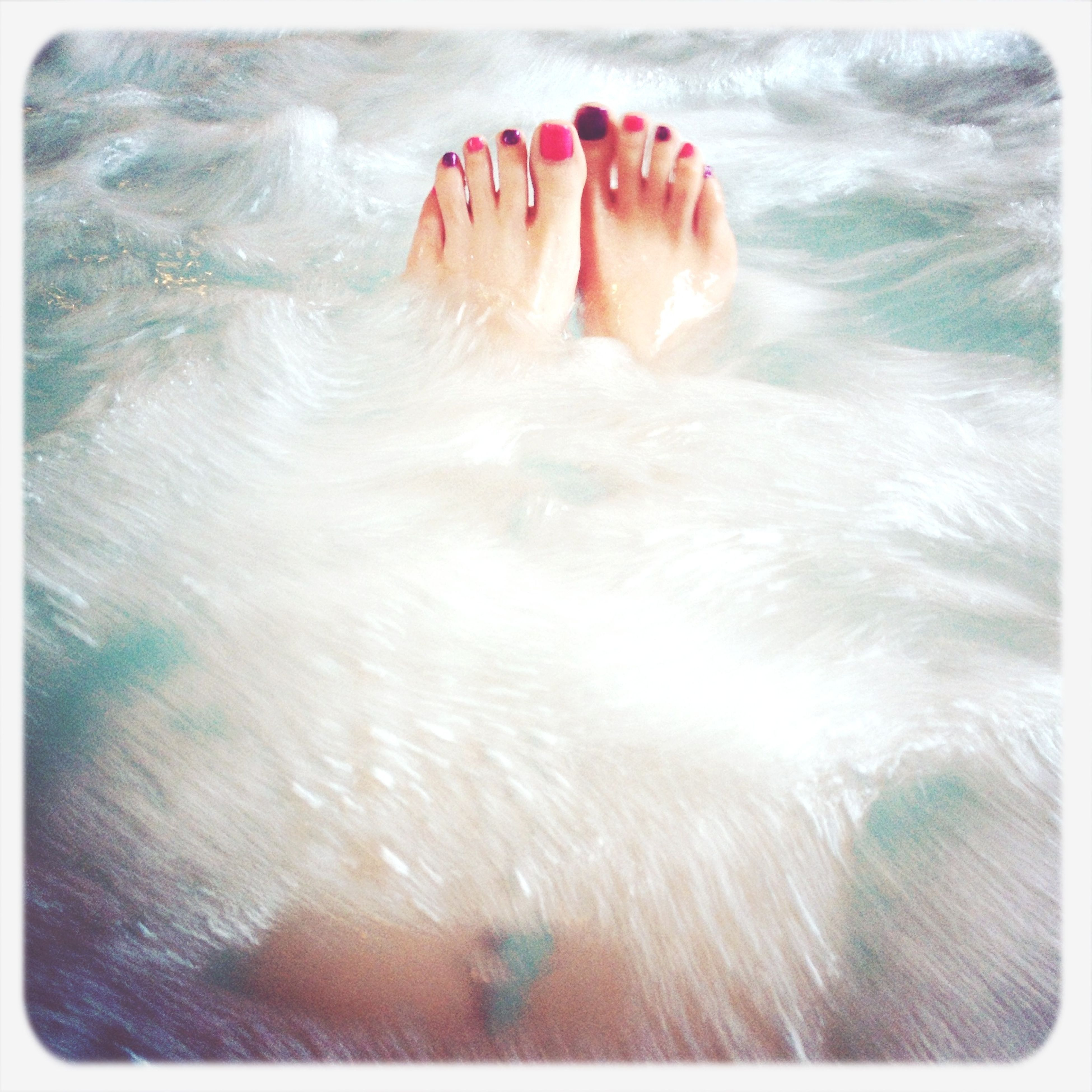 water, person, low section, barefoot, high angle view, auto post production filter, human foot, transfer print, leisure activity, lifestyles, part of, swimming, unrecognizable person, relaxation, sea, beach