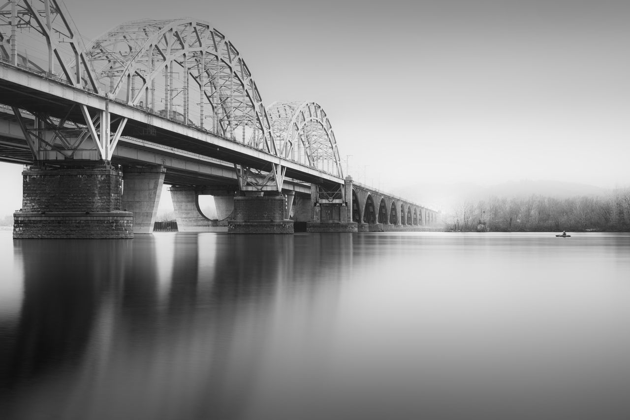 new darnytsky bridge in kyiv, ukraine Architecture Black And White Branch Bridge - Man Made Structure Built Structure Business Finance And Industry Connection Day Fine Art Fineart_photobw Fisherman Foggy Day Kyiv Long Exposure Man On Boat Misty Morning New Darnytskyi Bridge No People Outdoors Philipp Dase Sky Ukraine Water Winter