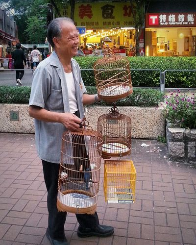 Senior Adult Full LengthCasual Clothing Real People Streetphotography City Life Outdoor Photography Mature Adult Retail  Adult People Store Outdoors Gray Hair Standing Lifestyle Day Cages Happy met his friends on the way Hang Hau
