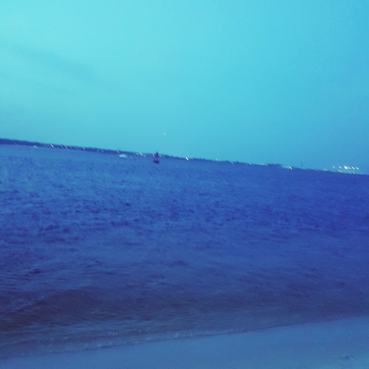 nature, sea, clear sky, tranquility, beauty in nature, scenics, tranquil scene, blue, beach, outdoors, idyllic, water, sky, landscape, day, horizon over water, no people