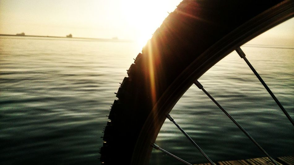 Bicycle Bike Boat Deck Close-up Horizon Over Water Light Nature No People Outdoors Sea Sky Sunlight Sunset Transportation Urban Lifestyle Water