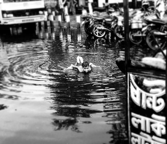Into each life some rain must fall Bnw_captures Childplay Innocence Rain RainyDay First Eyeem Photo