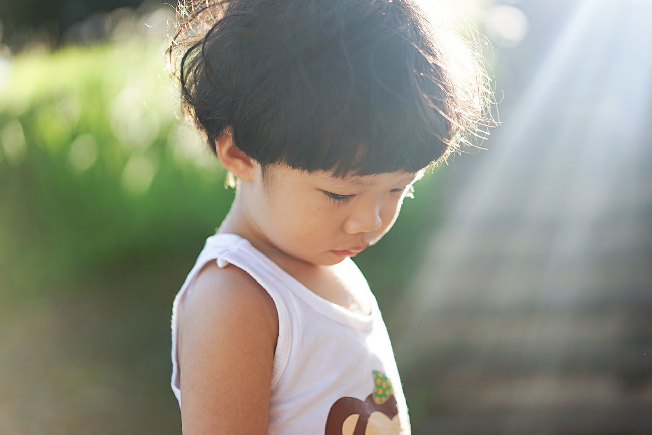 unhappy boy Asian Boy Child Childhood Children Only Close-up Cute Day Headshot Lonely Males  Nature One Person Outdoors People Portrait Sad Sadness Sunlight Unhappy Waist Up