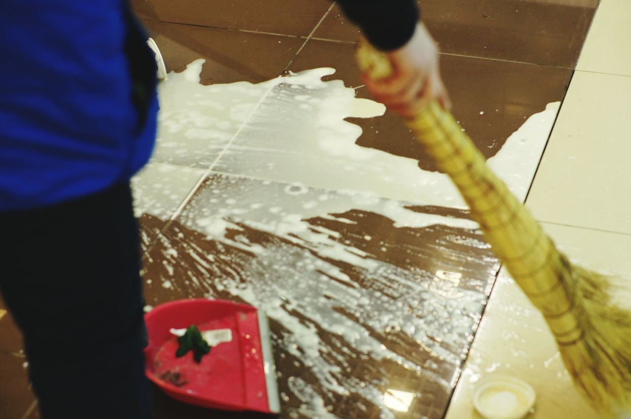 Indoors  Washing Spraying Human Hand Cleaning One Person Hygiene Close-up Adults Only Motion People Occupation Human Body Part Spilled Coffee Spilled Drink Floor Cleaning Working