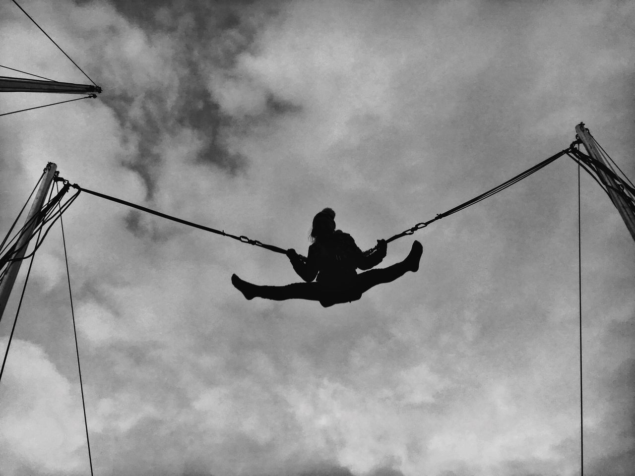Low Angle View One Person Sky Cloud - Sky Mid-air Jumping Swing Outdoors Real People Day Young Adult People One Man Only Adult Low Angle View Black & White Cold Temperature Vacations Leisure Activity